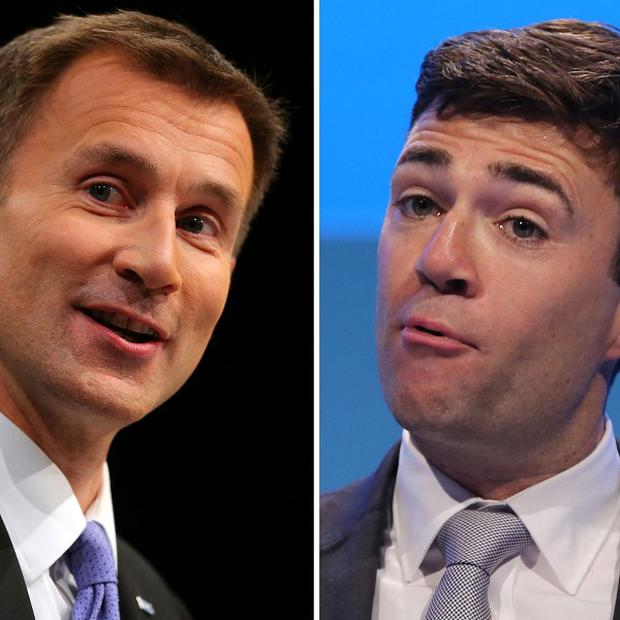 Health Secretary Jeremy Hunt,. left, has tried to cool his row with Labour's Andy Burnham