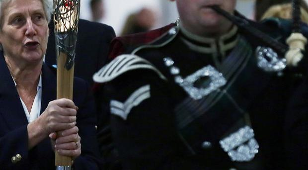 The Commonwealth Games baton is sent on its way from Glasgow Airport by Louise Martin