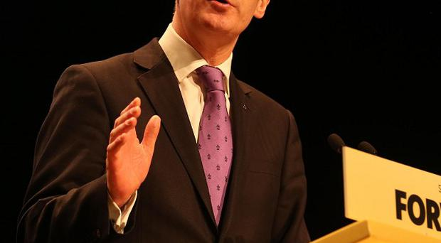 John Swinney said Scotland would be able to borrow, save and reduce debt simultaneously without raising taxes or cutting public services if it put some cash into an oil fund