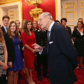 The Duke of Edinburgh chats to a group of young people during a reception to celebrate the 500th anniversary of his Duke of Edinburgh Award programme at St James's Palace in London