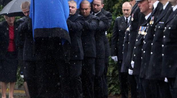 Mourners have paid tribute to Pc Andrew Duncan who was killed when he was run over while trying to stop a vehicle.