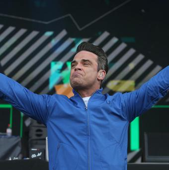 Robbie Williams has spoken with emotion about the experience of fatherhood.