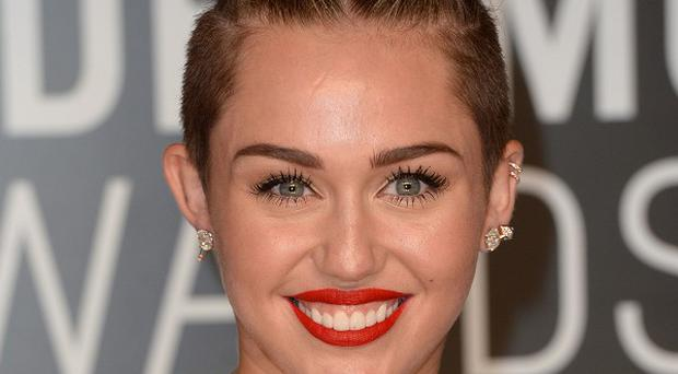 Miley Cyrus is celebrating a 'double', having reached number one in both the single and album charts