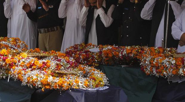 People attend funeral prayers for victims of an explosion in Peshawar, Pakistan (AP/Mohammad Sajjad)