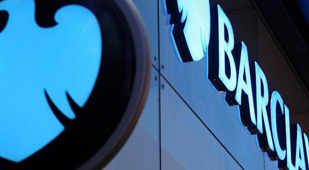 The 15-year-old held up a branch of Barclays in Liverpool and made off with more than £2,000
