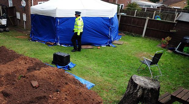 A murder inquiry has been launched after the bodies of an elderly couple were unearthed in the garden of a house in Mansfield, Nottinghamshire