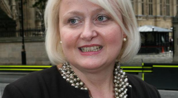 Journalist Nick Parker and a member of the public are facing charges linked to the theft of a mobile phone belonging to MP Siobhain McDonagh, pictured
