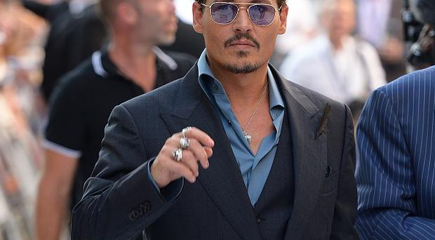 Johnny Depp, pictured at the UK premiere of The Lone Ranger, earlier this year, made a surprise appearance to honour his friend Sir Christopher Lee at the London Film Festival Awards.