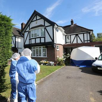 Forensic officers outside the Claygate home of French shooting victim Saad al-Hilli