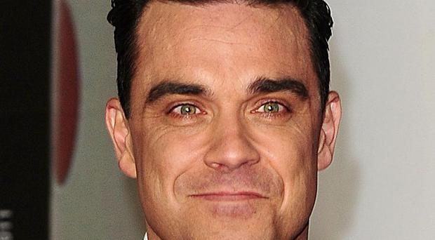 Robbie Williams' contribution to music has been hailed at the Q Awards