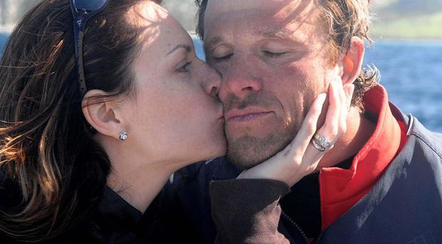 Beverley Turner kissing James Cracknell on the shores of Morocco after his swim across the Strait of Gibraltar from in aid of Sport Relief with David Walliams.