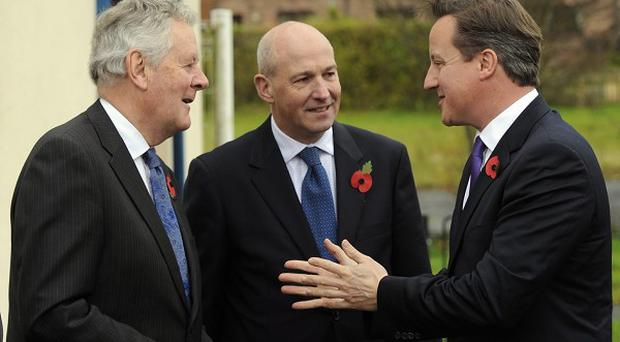 Mr Rhodes, left, with Prime Minister David Cameron (right) and Carlisle MP John Stevenson (centre), during campaigning for the PCC elections.