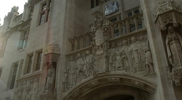 Supreme Court justices in London will rule in the case of a woman who nearly drowned during a swimming lesson in 2000
