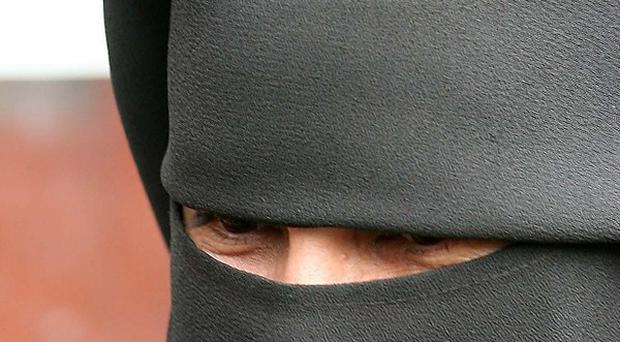 A majority of people believe women should not wear the niqab in public, a poll suggests.