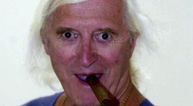 Jimmy Savile's former flatmate and chauffeur has been charged with a series of serious sex offences against young girls