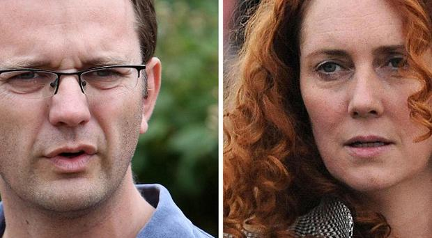 Former government spin doctor Andy Coulson and ex-News International chief executive Rebekah Brooks.