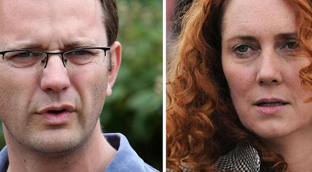 Former government spin doctor Andy Coulson and ex-News International chief executive Rebekah Brooks