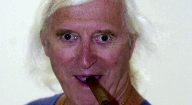 File photo dated 15/8/2000 of Jimmy Savile as lurid details of his alleged sexual abuse have been made public for the first time after transcripts of a police interview were published by Surrey Police.