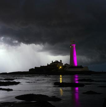 Dark clouds are seen behind St Mary's Lighthouse, Whitley Bay, North Tyneside.