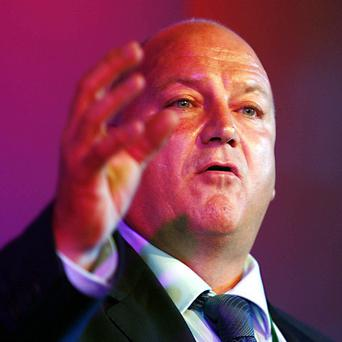 RMT chief Bob Crow has attrributed the virtual shutdown of rush-hour train services because of the storm to staff numbers being