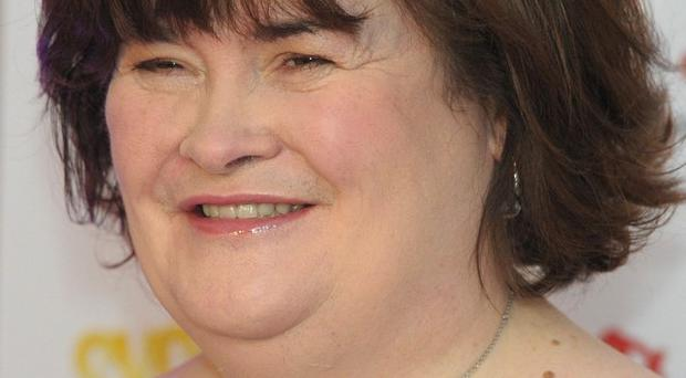 Susan Boyle's duet with Elvis Presley is being released as a Christmas single, and there are also plans for a biopic about the singer's rise to fame