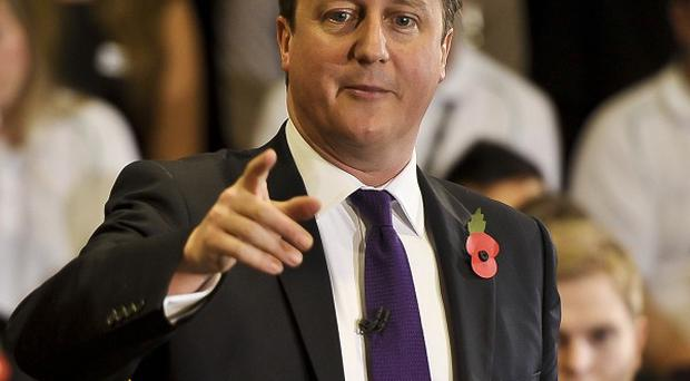Prime Minister David Cameron said it would be very difficult for the Government to stand back if the press did not show some social responsibility when in possession of intelligence material.