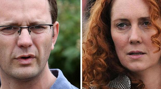 Former Government spin doctor Andy Coulson and ex-News International chief executive Rebekah Brooks. They are among eight defendants in a trial that could last up to six months.