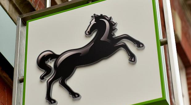 Lloyds back in red after £8bn payment protection insurance bill