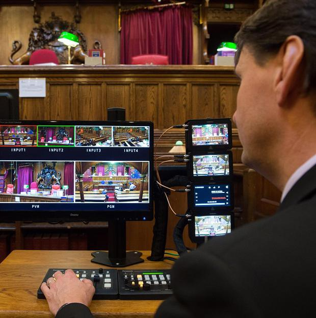 A man checks the monitors in Court Four at the Royal Courts of Justice in London, which has been fitted with TV cameras to broadcast live pictures from selected cases from October 31