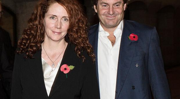 Rebekah and Charlie Brooks leave the Old Bailey in London on Wednesday