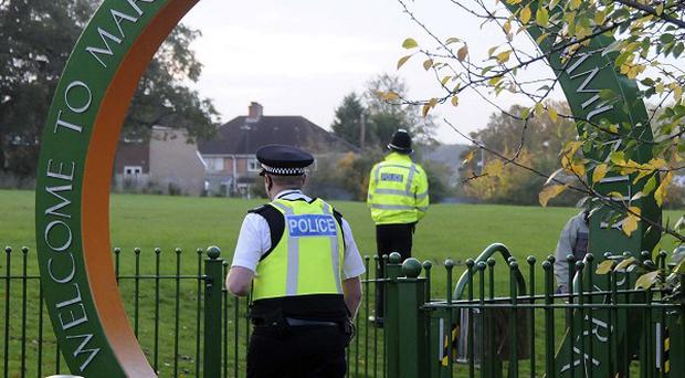 Police at the scene where a newborn baby girl was found abandoned in a carrier bag