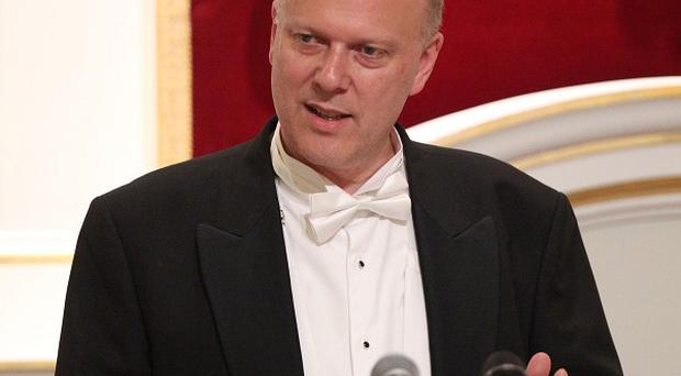 Justice Secretary Chris Grayling's review of legal aid has been condemned by law bodies.