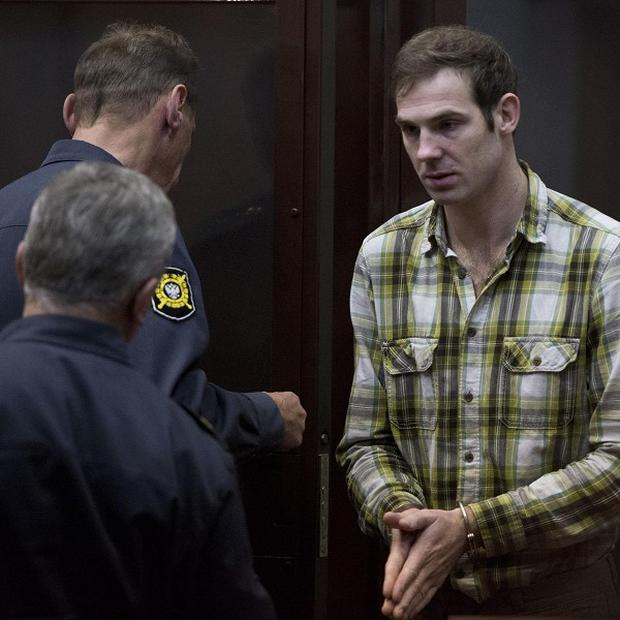 Kieron Bryan appears at a bail hearing at the regional court of Murmansk, Russia (Greenpeace/PA)