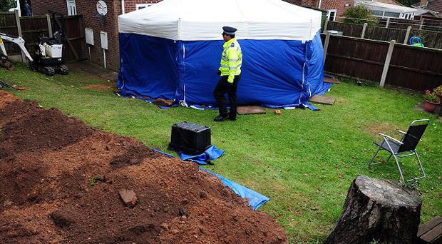 A general view of a police tent in the garden of a house in Mansfield where the remains of two people have been found.