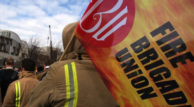 Firefighters have mounted picket lines outside fire stations