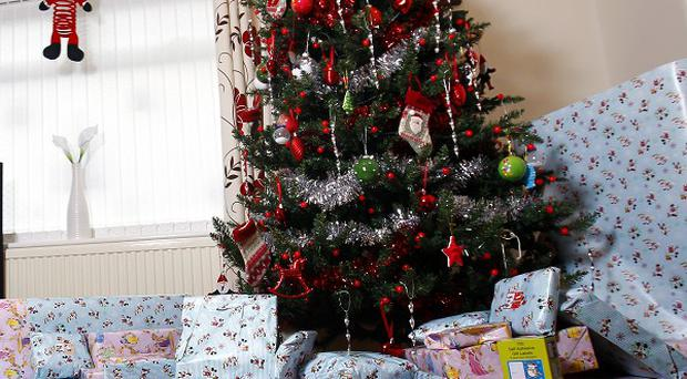 Around £145 will be spent on presents for each child this year, 10% more than a year ago, a survey suggests