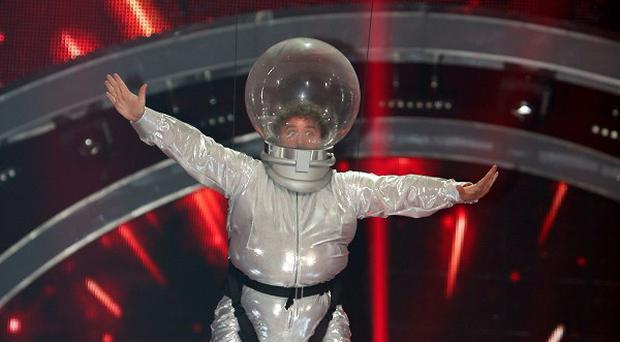 Mark Benton flies through the air in a spaceman costume during a rehearsal for his Halloween dance routine.