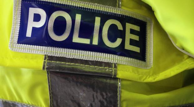 A man has been arrested following the death of two teenage girls in a road traffic collision