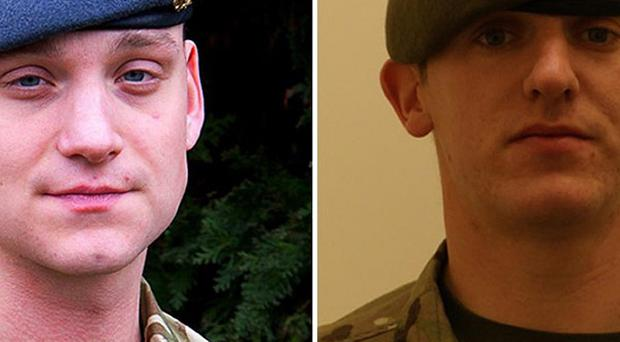 Cpl Brent McCarthy, left, and L/Cpl Lee Davies died of gunshot wounds in an attack at an Afghan police base last year (MoD/PA)