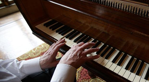 Playing endless scales on a piano pay dividends in middle and old age by honing your hearing, say scientists