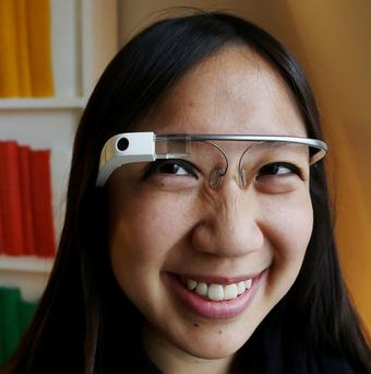 Teresa Wu, Google Glass operations programme manager, uses Google Glass during a live demonstration of Google Voice capabilities in London