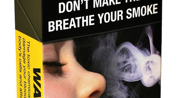 A Cancer Research UK image of a plain cigarette pack - the Scottish Government says tobacco firms will not stop the legislation coming through