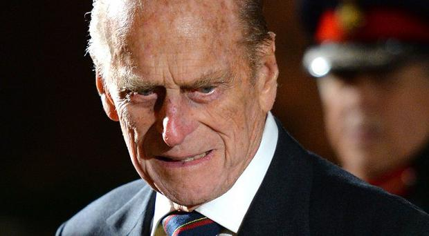 The Duke of Edinburgh arrives to view the plaque commemorating the renaming of the South Steps at the Royal Albert Hall to Queen Elizabeth II Diamond Jubilee Steps, in central London.