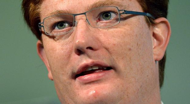 The father of Chief Secretary to the Treasury Danny Alexander has criticised the 'bedroom tax'
