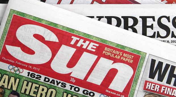 The editor of The Sun newspaper has said Page 3 pin-ups will continue to feature