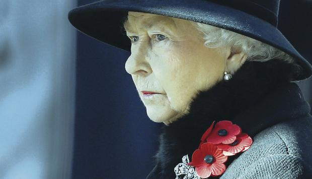 The Queen listens to the service of remembrance