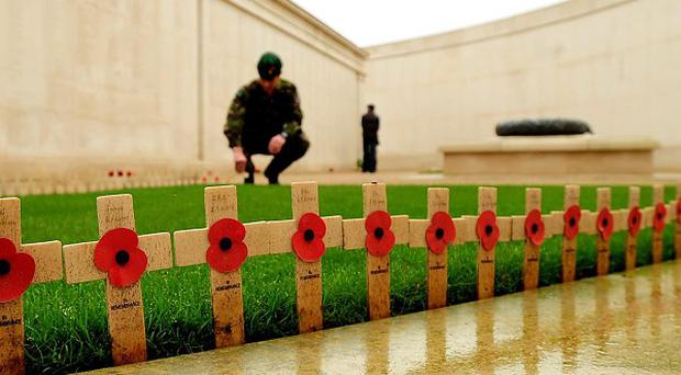 Remembrance crosses at the Armed Forces Memorial in preparation for a Service of Remembrance on Armistice Day at the National Memorial Arboretum, Alrewas, Staffordshire