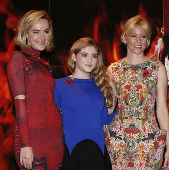 Jena Malone, Willow Shields and Elizabeth Banks ahead of the premiere of The Hunger Games: Catching Fire.