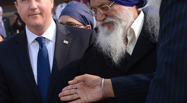 Prime Minister David Cameron is shown around the Golden Temple at Amritsar during his last visit to the country