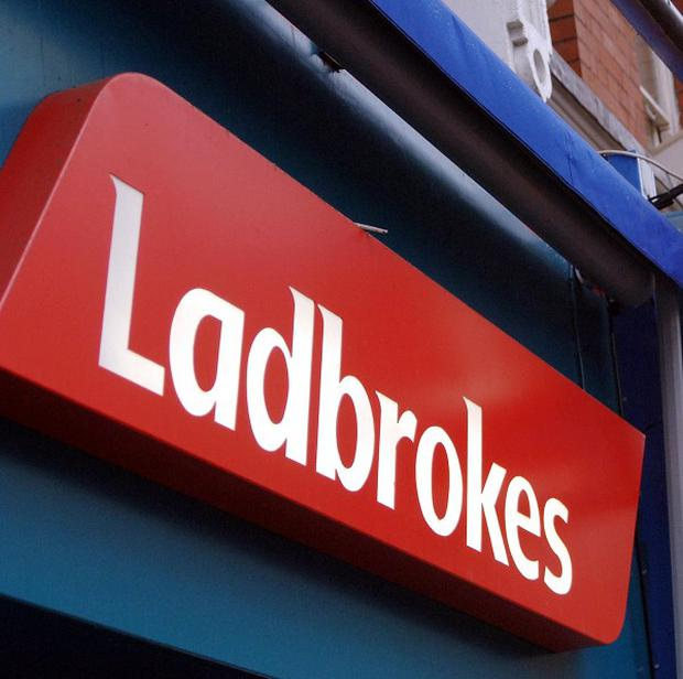 An inquest will take place into the death of an armed robber who died during a raid at a branch of Ladbrokes